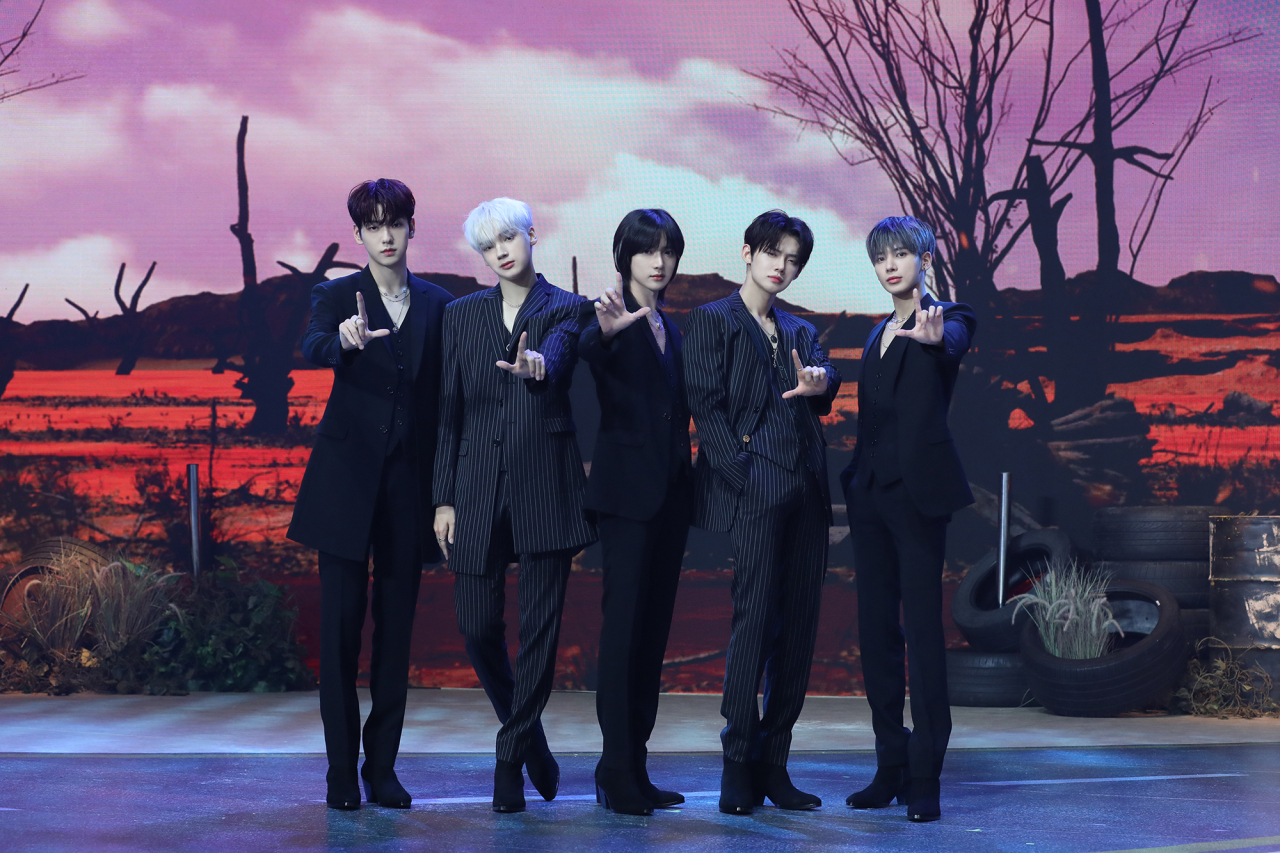 Boy band Tomorrow x Together poses during an online press conference Tuesday. (Big Hit Music)