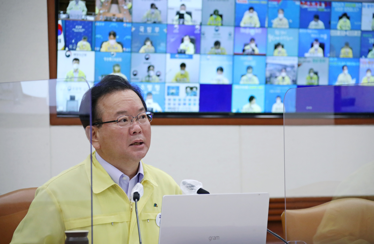 Prime Minister Kim Boo-kyum speaks during an interagency meeting on COVID-19 at the government office complex in Seoul on Friday. (Yonhap)