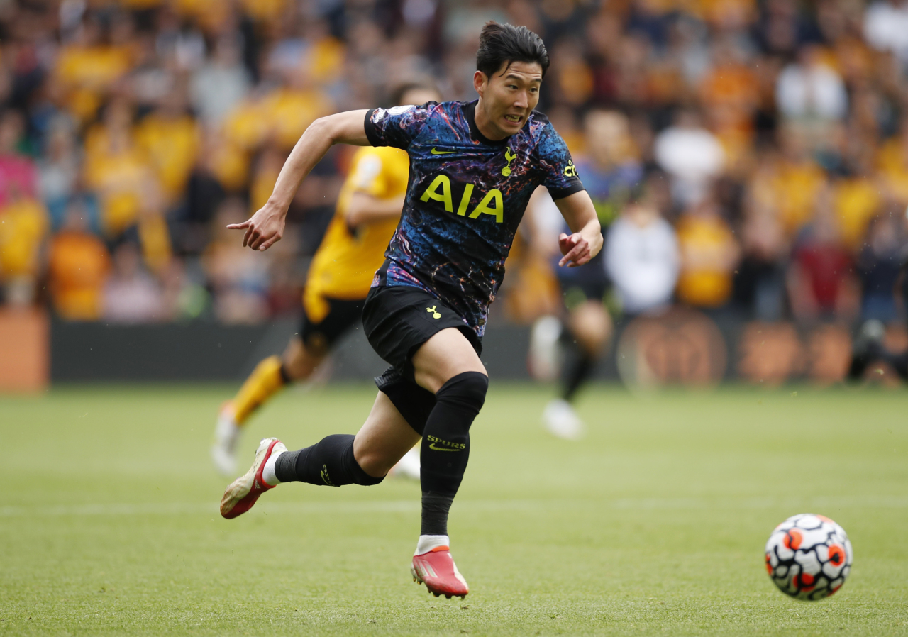 In this Action Images photo via Reuters, Son Heung-min of Tottenham Hotspur dribbles the ball during a Premier League match against Wolverhampton Wanderers at Molineux Stadium in Wolverhampton, England, on Aug. 22, 2021. (Reuters-Yonhap)