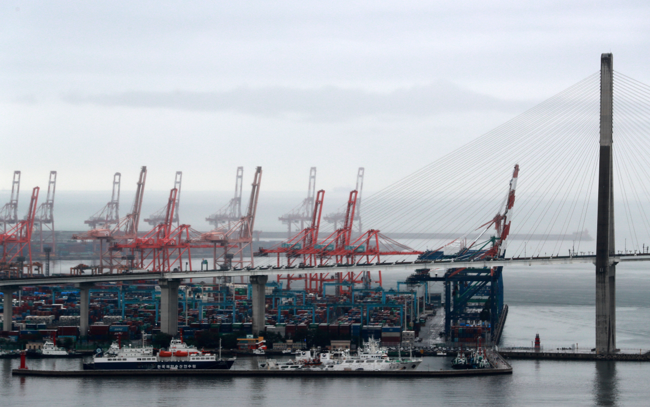 Cargo ships docked at a port in Busan, Monday. (Yonhap)