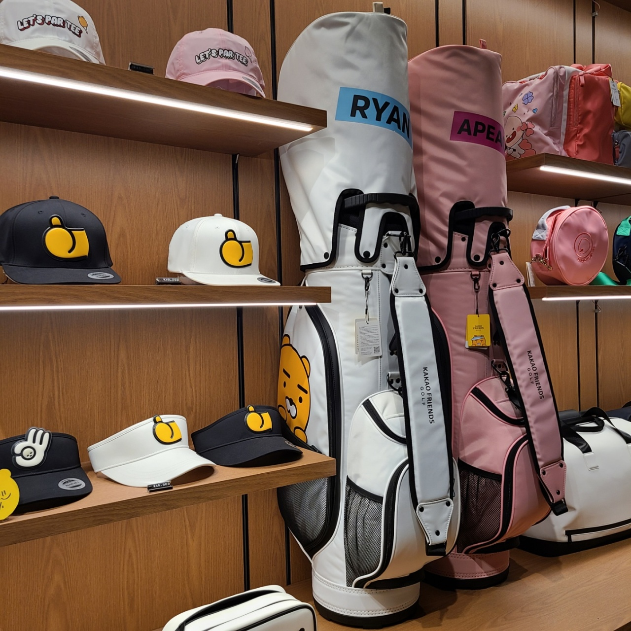 """Golf bags and golf caps designed with Kakao friend's characters are displayed on the shelves of the equipment shop of Kakao VX's """"Friend's Screen"""" screen golf zone in Pangyo, Gyeonggi Province. (The Korea Herald/Kang Jae-eun)"""