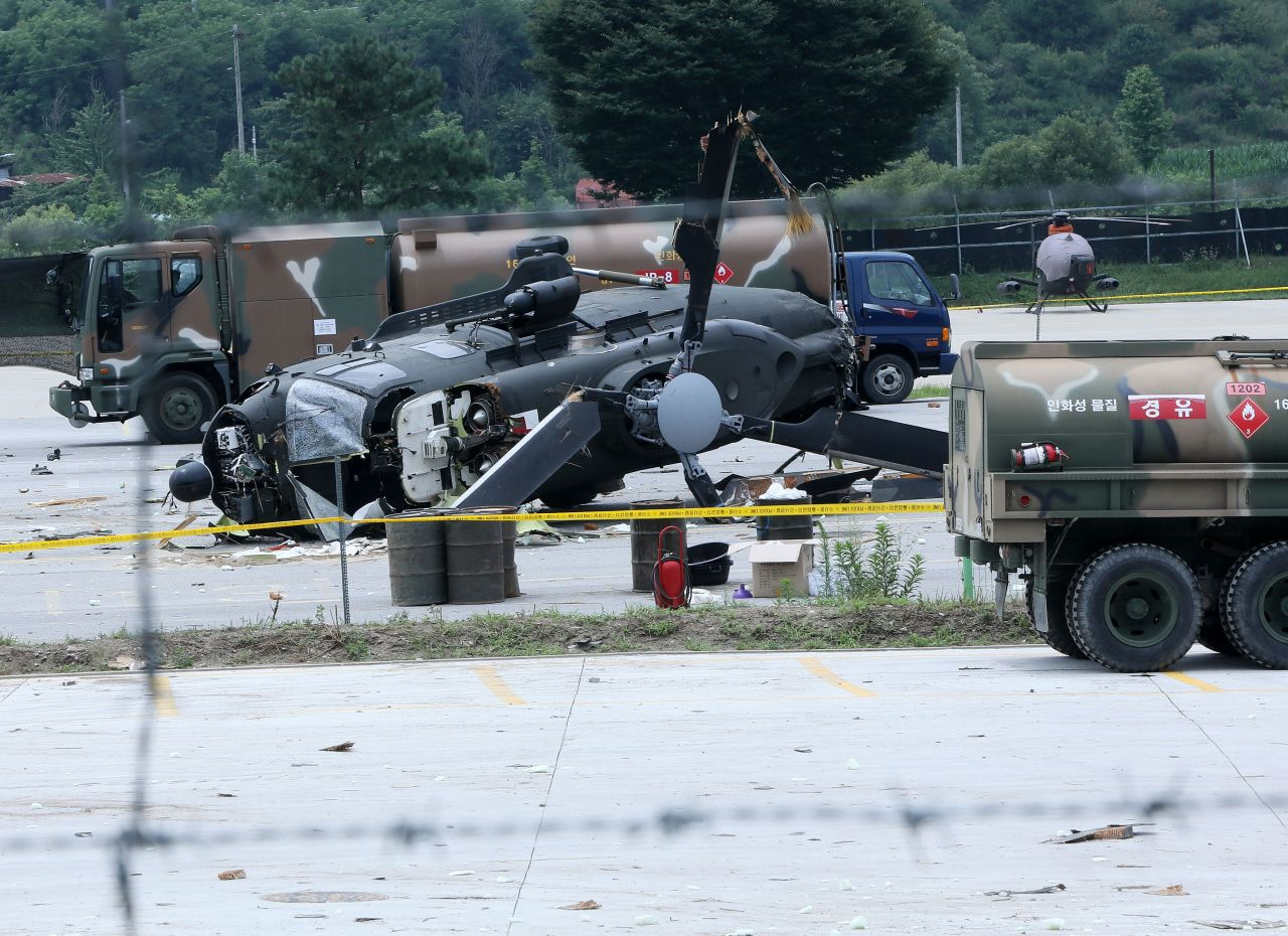 In this file photo, an Army ambulance helicopter is seen partially destroyed at an aviation battalion base in Pocheon, 46 kilometers north of Seoul, on July 12, 2021, after the aircraft crash-landed on the airstrip, leaving five people aboard injured. (Yonhap)