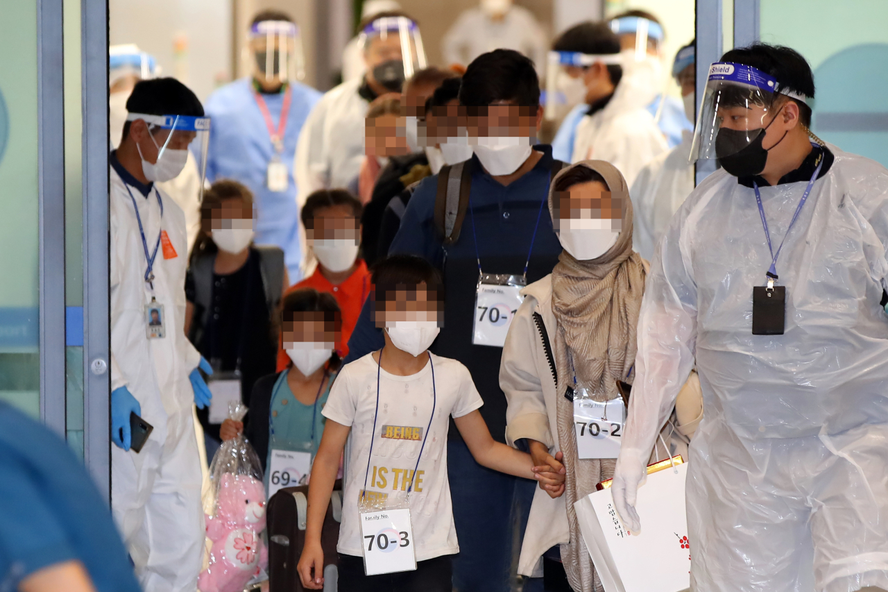 The second group of Afghan evacuees arrives at Incheon Airport, west of Seoul, on Friday, as South Korea completes an operation to evacuate local co-workers of the country's embassy and other facilities in the war-torn nation and their families after the Taliban's seizure of power. (Yonhap)