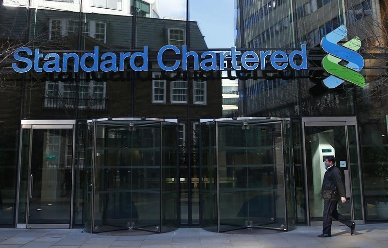 A man walks past the head office of Standard Chartered bank in the City of London February 27, 2015.(Reuters)