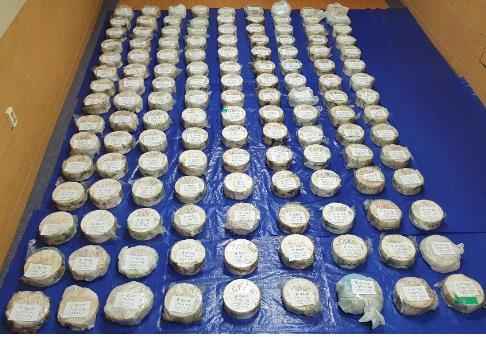 This photo provided by the Busan District Prosecutors Office shows 135 bags of methamphetamine confiscated from a smuggling suspect. (Busan District Prosecutors Office)