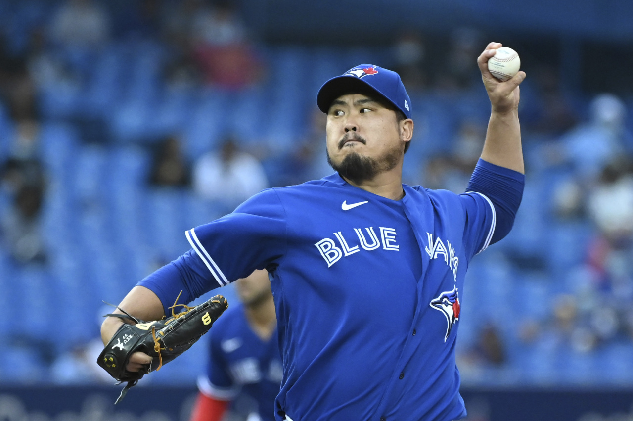 n this USA Today Sports photo via Reuters, Ryu Hyun-jin of the Toronto Blue Jays pitches against the Baltimore Orioles during the top of the first inning of a Major League Baseball regular season game at Rogers Centre in Toronto on Tuesday. (Yonhap)