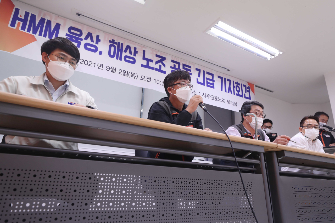 Representatives of two labor unions at HMM talk to the press Thursday morning during an emergency press meeting held in Jung-gu, central Seoul. (Yonhap)