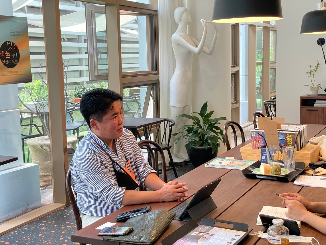 Kim Ui-jin, a North Korean defector and insurance agent in South Korea, talks to The Korea Herald in Seoul in July. (Park Ga-young/The Korea Herald)