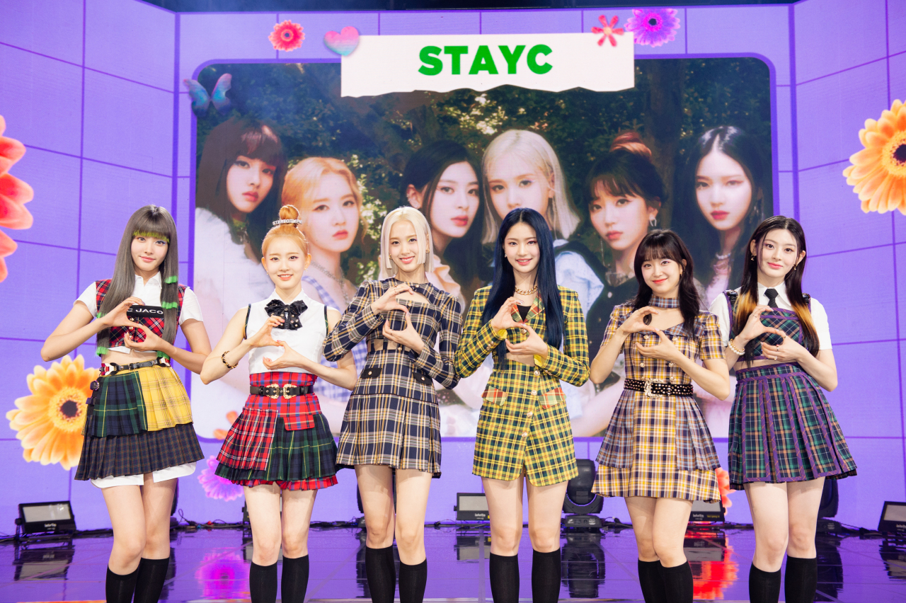 Girl group StayC poses during an online press conference Monday. (High Up Entertainment)