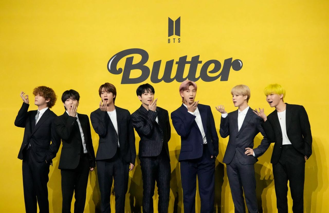 BTS pose for photographers ahead of a press conference to introduce their new single