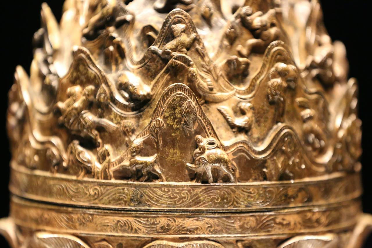 """The Gilt-bronze Incense Burner of Baekje, Korea's National Treasure No. 287, stands 61.8 centimeters tall and weighs 11.8 kilograms. It clearly features animals from distant Southeast Asian places, such as an elephant, which show the far reaches of the Baekje Empire's maritime presence and empire's 22 """"damro"""" vassal states."""