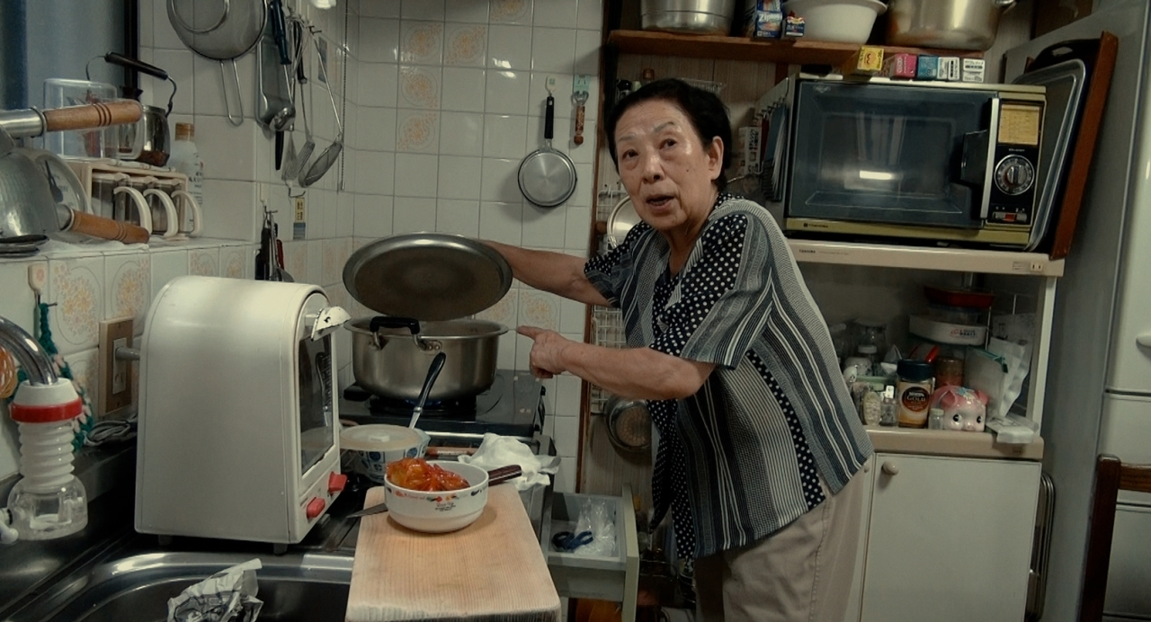 """Director Yang Yong-hi's mother prepares samgyetang for her future son-in-law in """"Soup and Ideology."""" (DMZ International Documentary Film Festival)"""