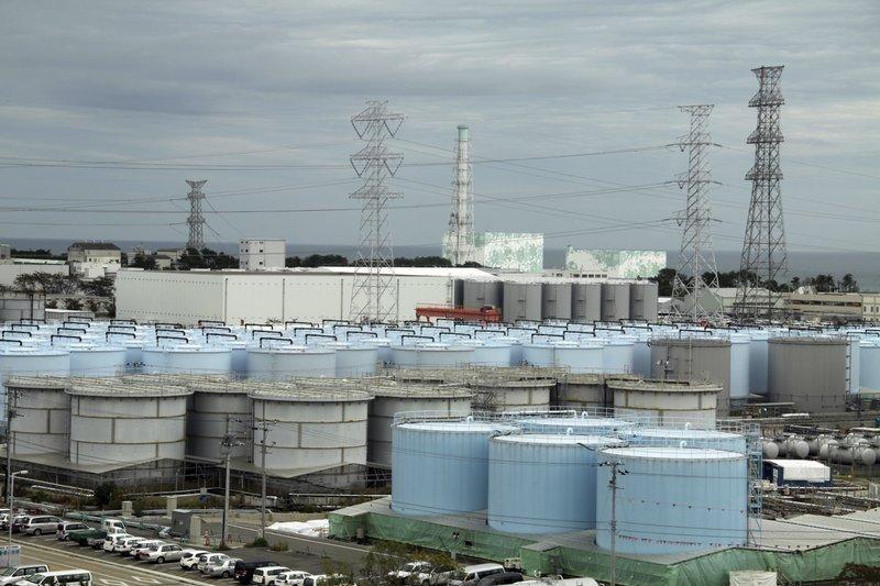Storage tanks for treated contaminated water are seen at Fukushima Daiichi nuclear power plant in Okuma town, Fukushima prefecture. (AP-Yonhap)