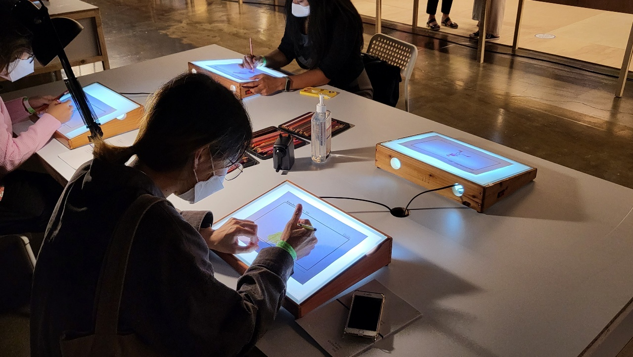Participants' work at DIY webtoon drawing events, to be collected to make one final piece after the book fair. (Kim Hae-yeon/The Korea Herald)