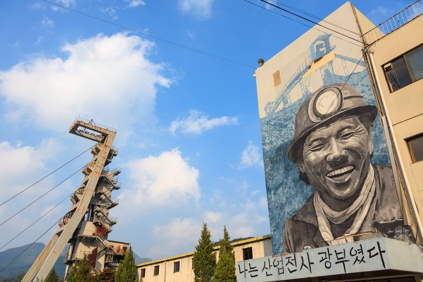 A wall painting of a miner and the blue sky at an abandoned coal mine in South Korea. (123rf)