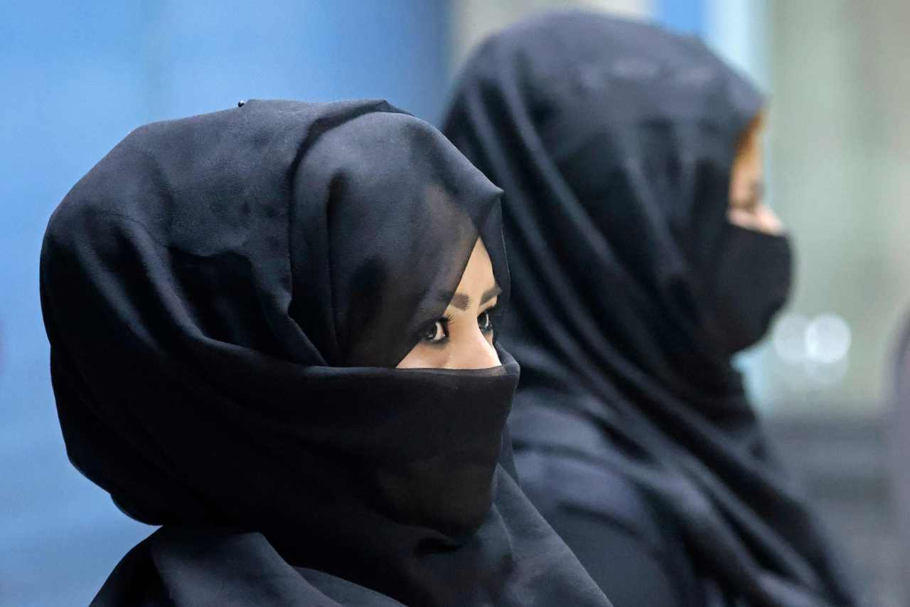 Afghan women airport workers are pictured at a security checkpoint of the airport in Kabul on Sunday. (AFP-Yonhap)