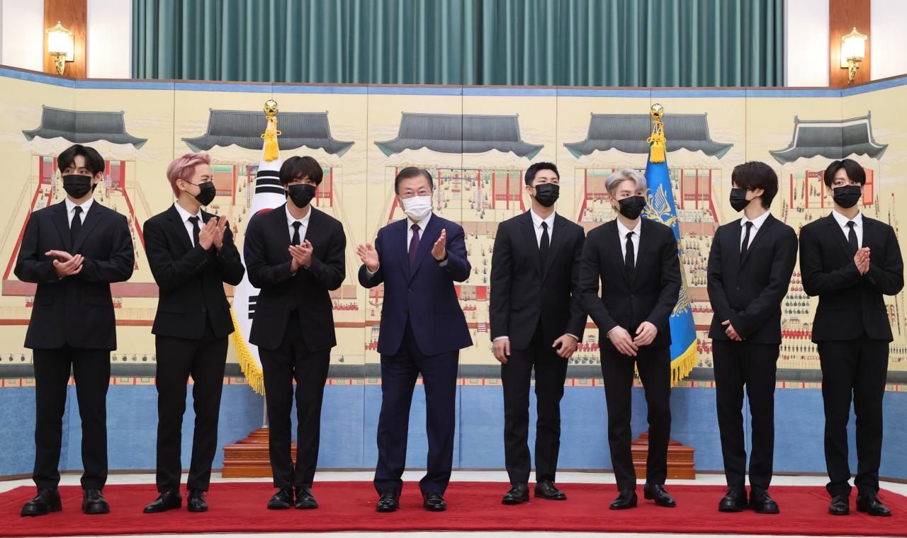 South Korean president Moon Jae-in (fourth from left) and members of BTS -- (from left) V, J-Hope, Jin, RM, Suga, Jimin and Jungkook -- pose for picture during certificate presentation ceremony for special envoy appointment at Cheong Wa Dae on Sept. 14, 2021. (Yonhap)