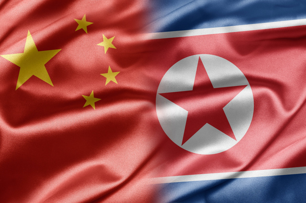Flags of China and North Korea (123rf)