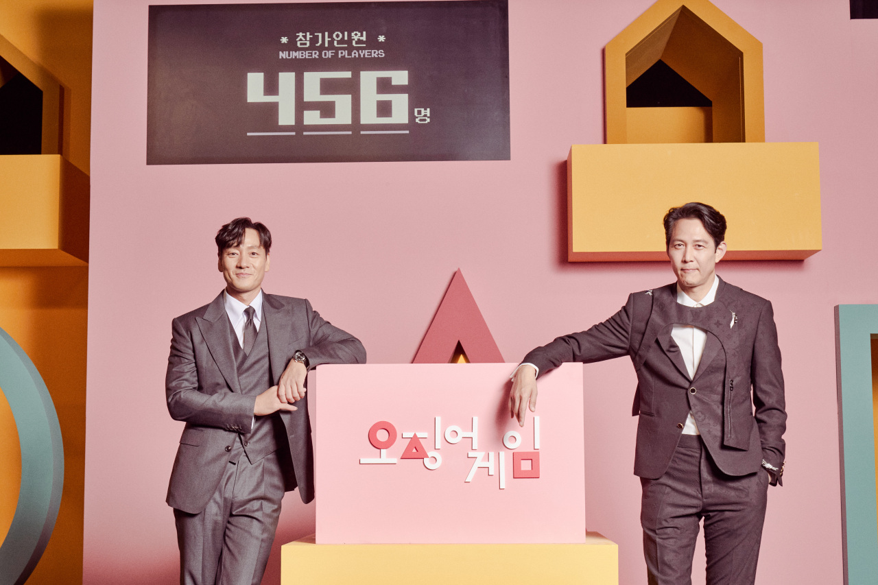 Actors Park Hae-soo (left) and Lee Jung-jae pose for a photo after an online press conference held on Wednesday. (Netflix)