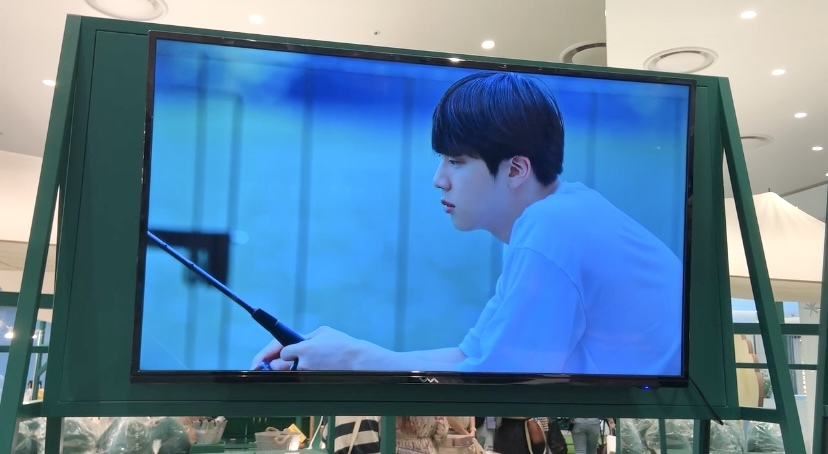 """A scene from BTS' version of """"In the Soop"""" shows bandmate Jin fishing in the woods. (Park Jun-hee/The Korea Herald)"""