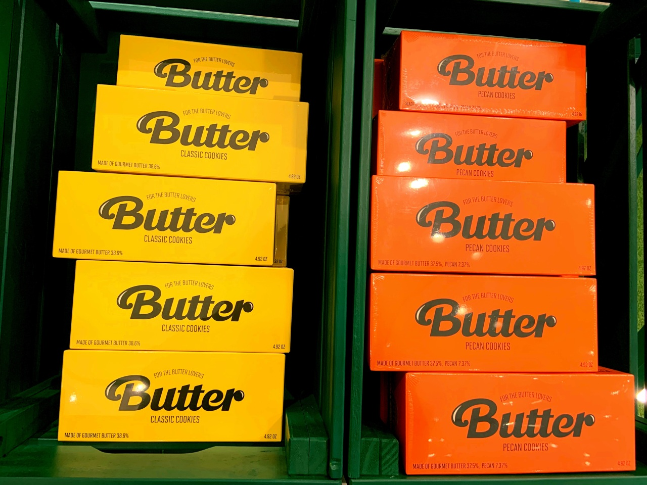 """Orange and yellow boxes of cookies named after BTS' megahit song """"Butter"""" are displayed on a rack. (Park Jun-hee/The Korea Herald)"""