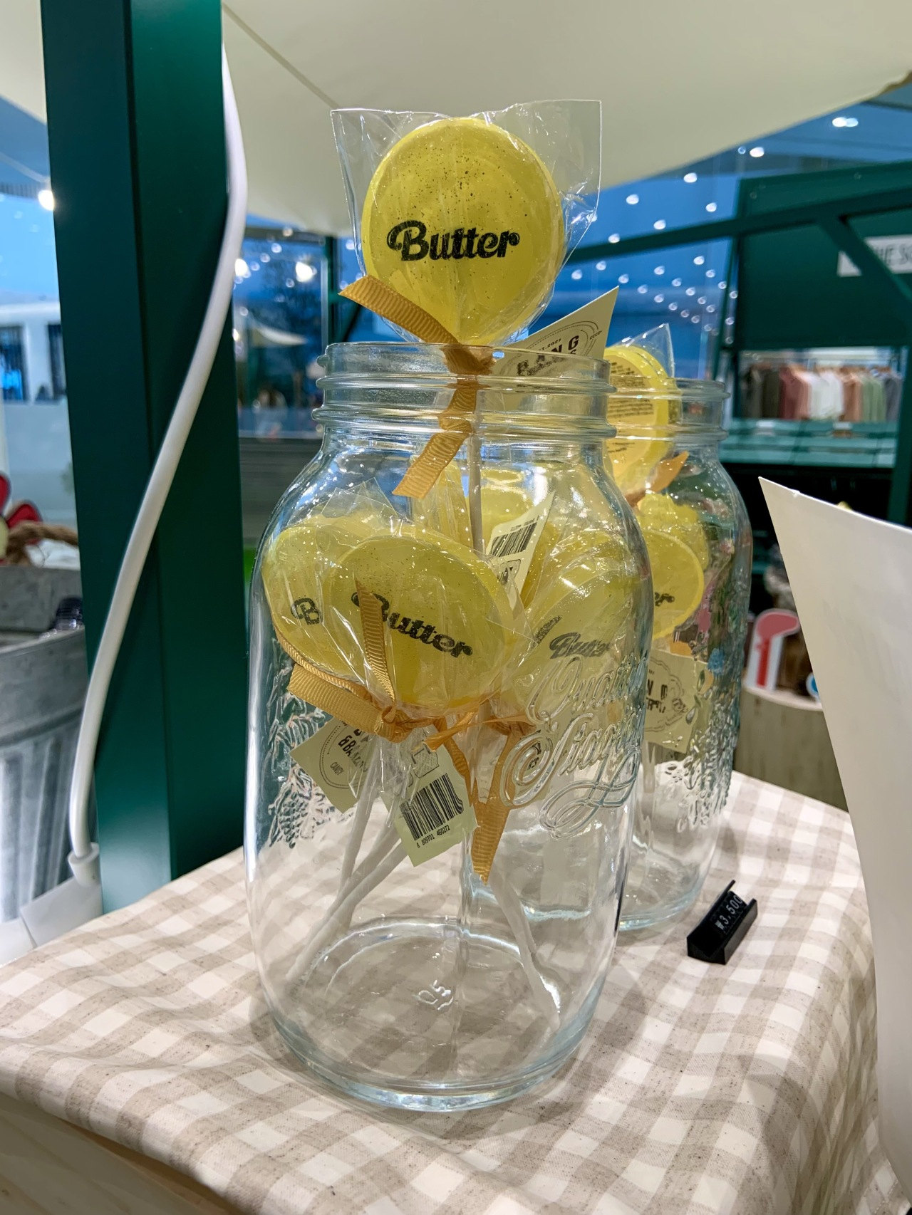 """BTS-themed lollipops named after the band's megahit song """"Butter"""" are displayed inside a glass bottle. (Park Jun-hee/The Korea Herald)"""