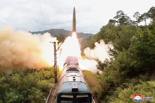 his photo, released by North Korea's official Korean Central News Agency (KCNA) on Thursday, shows a railway-borne missile regiment holding a firing drill a day earlier. (Yonhap)