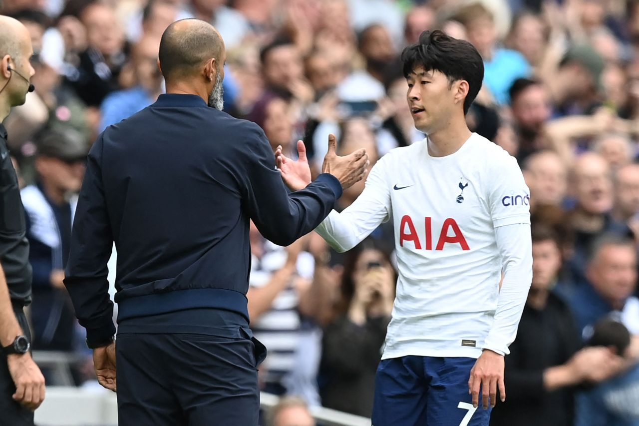 In this AFP file photo from Aug. 29, 2021, Son Heung-min of Tottenham Hotspur (R) shakes hands with his head coach Nuno Espirito Santo as he leaves a Premier League match against Watford at Tottenham Hotspur Stadium in London. (Yonhap)