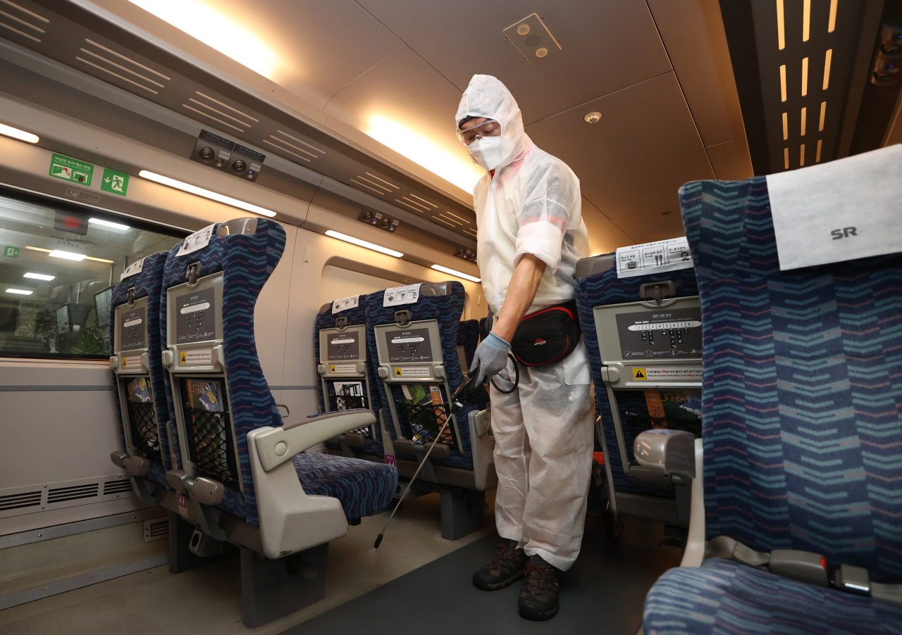 A health worker disinfects a cabin of a train at Suseo Station in Seoul on Wednesday. (Yonhap)
