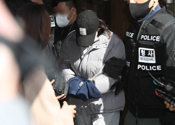 This file photo show a woman from the southeastern city of Gumi surnamed Kim, who was convicted of abandoning a 3-year-old girl in an empty house and causing her death. (Yonhap)