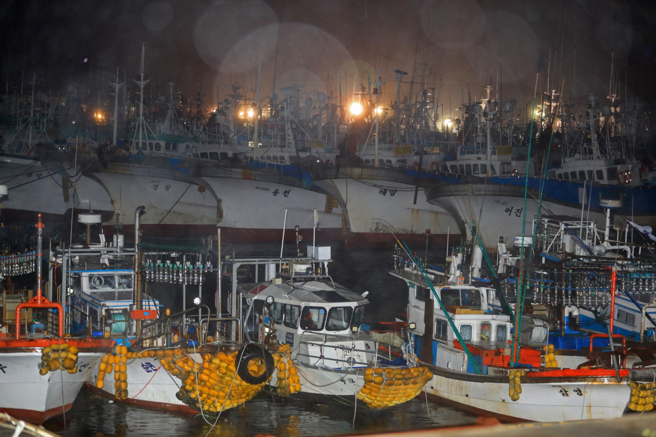 Fishing ships are tied up at a port in Jeju, South Korea in anticipation of the arrival of Typhoon Chanthu on Thursday. (Yonhap)