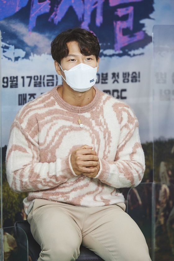 """Kim Jong-kook speaks during an online press conference for MBC's """"The Wild Idol"""" held on Friday. (MBC)"""