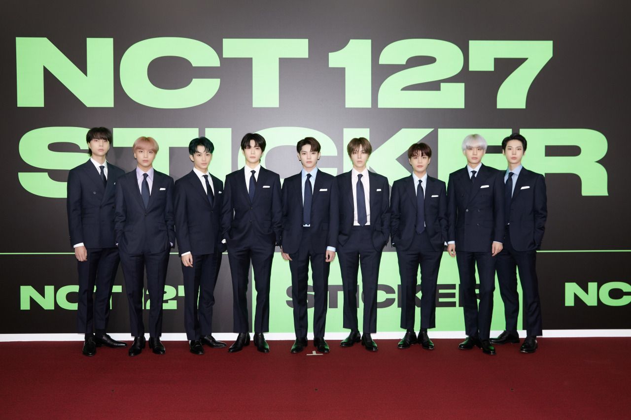 """NCT 127 poses at the """"Sticker"""" media showcase Friday. (S.M. Entertainment)"""