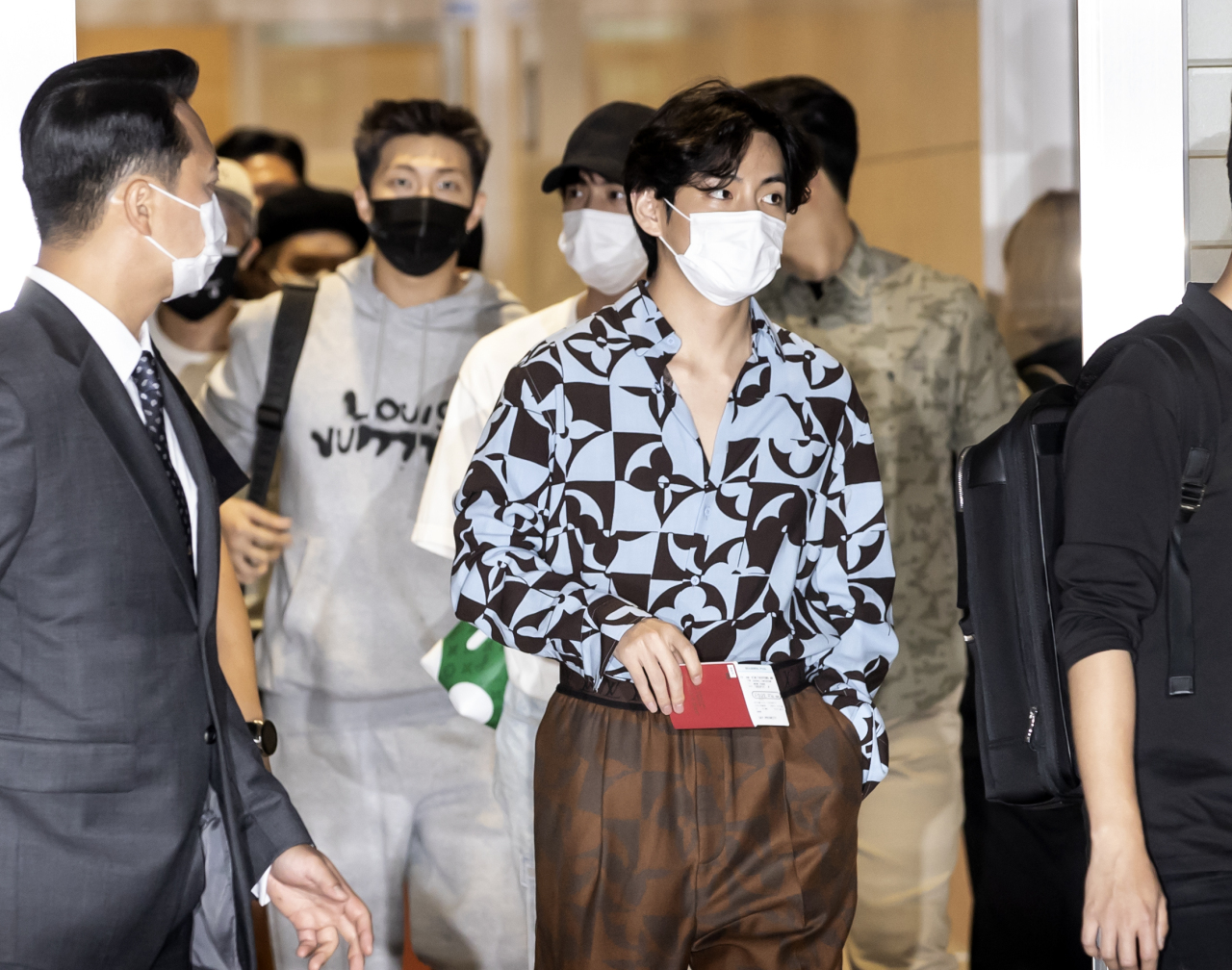 K-pop boy band BTS' members including V (front row, right) are seen walking at the Incheon International Airport terminal 2 Saturday to attend a United Nations event as a special presidential envoy in New York. (Yonhap)