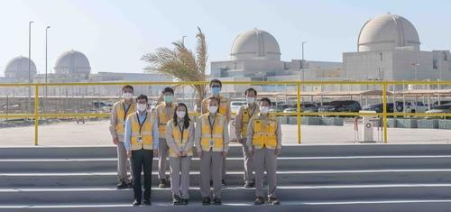Park Il (2nd from R, front row), the foreign ministry's director general for nonproliferation and nuclear affairs, and other officials pose for a photo during a recent visit to a nuclear power plant in the United Arab Emirates, in this photo released on Friday, by the ministry. (Ministry)