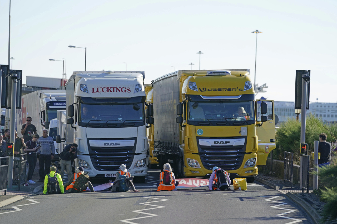 Protesters from Insulate Britain block the A20 which provides access to the Port of Dover, in Kent, England, on Friday. (AP-Yonhap)