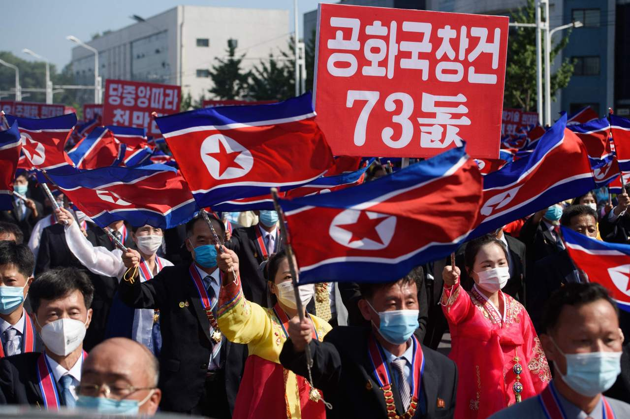 People march as they take part in a mass demonstration in Pyongyang on Sept. 9, to mark 73 years since the foundation of the Democratic People's Republic of Korea (DPRK), as North Korea is officially known. (AFP-Yonhap)