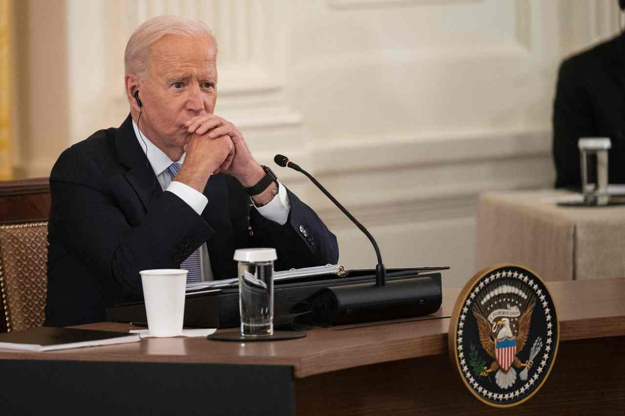 US President Joe Biden listens as India Prime Minister Narendra Modi speaks with Japan Prime Minister Suga Yoshihide and Australian Primer Minister Scott Morrison during the first-ever in-person Quad Leaders Summit in the East Room of the White House in Washington, DC, on Friday. (AFP-Yonhap)