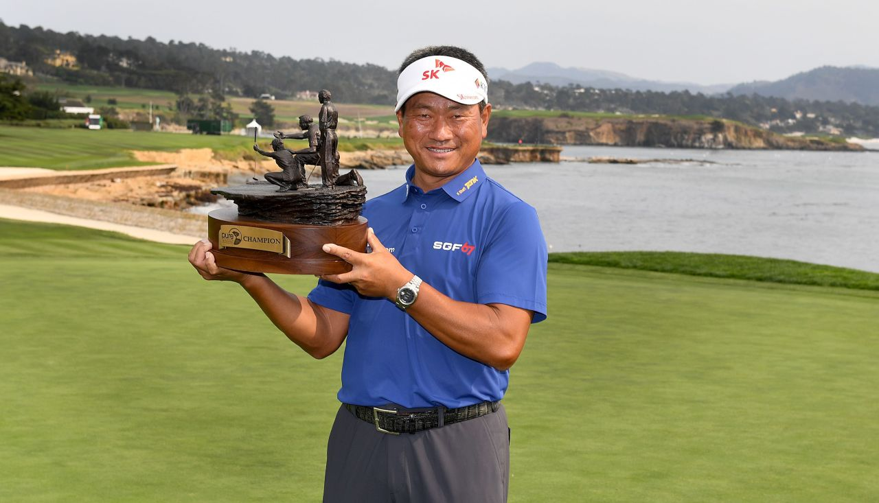 In this Getty Image photo moved by AFP, Choi Kyoung-ju of South Korea holds the trophy after winning the PURE Insurance Championship at the Pebble Beach Golf Links in Pebble Beach, California, on Sunday. (Yonhap)