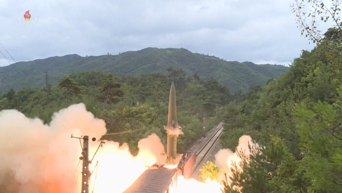 This photo, captured from North Korea's official Korean Central Television on Sept. 16, 2021, shows a short-range ballistic missile being fired from a train in a central mountainous area of the North the previous day. (Yonhap)