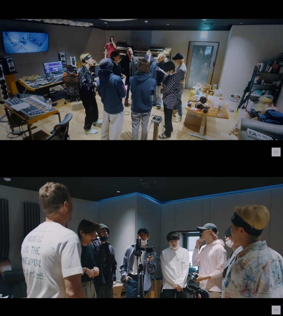 These stills, provided by Big Hit Music, show BTS and Chris Martin in a documentary about their collaboration single