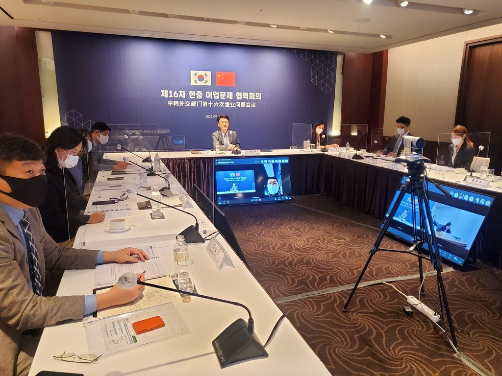 South Korean officials participate in regular fisheries talks with China via video links from Seoul on Sept. 28, 2021, in this photo released by the foreign ministry. (Yonhap)