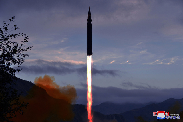 This photo released by the Korean Central News Agency on Wednesday, showed what North Korea claims to be a new hypersonic missile being launched. (Yonhap)