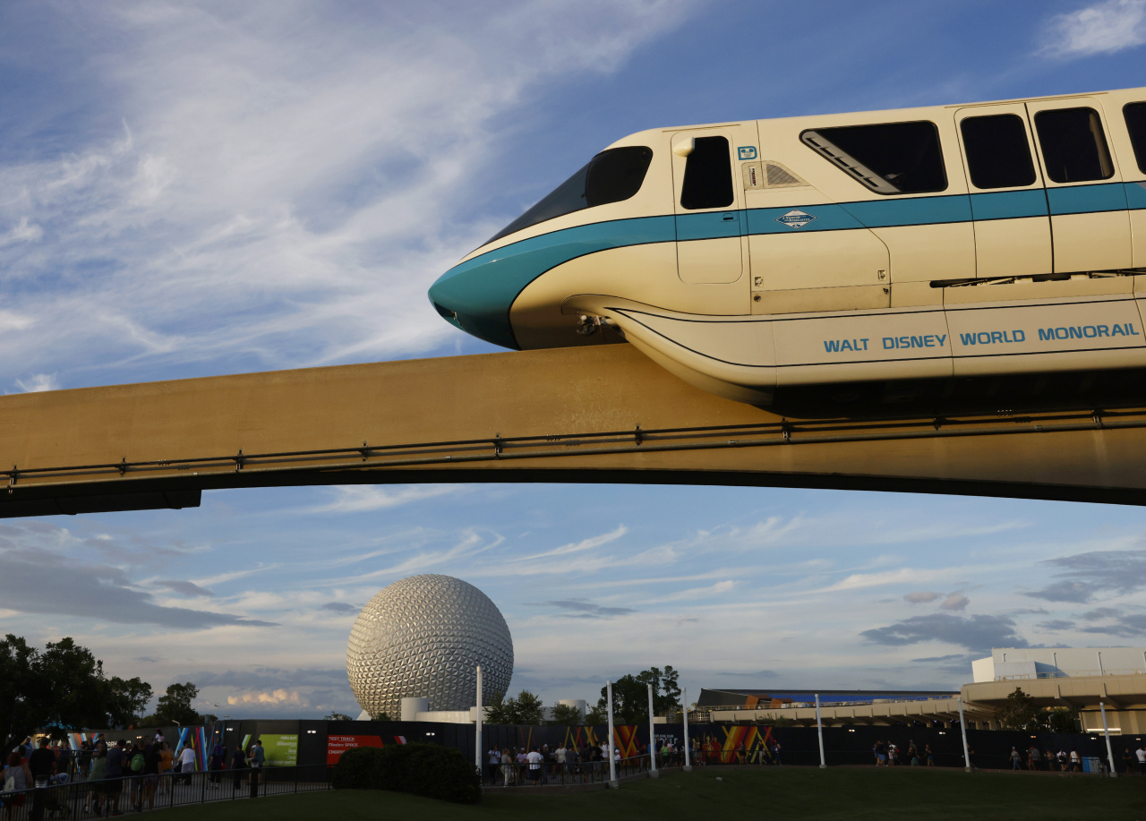 The Walt Disney World Monorail System passes by Spaceship Earth.