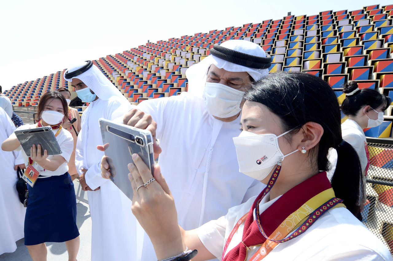 A visitor holds up a mobile device to launch the augmented reality program at the Korea Pavilion at the Expo 2020 Dubai on Friday. (Courtesy of Kotra)