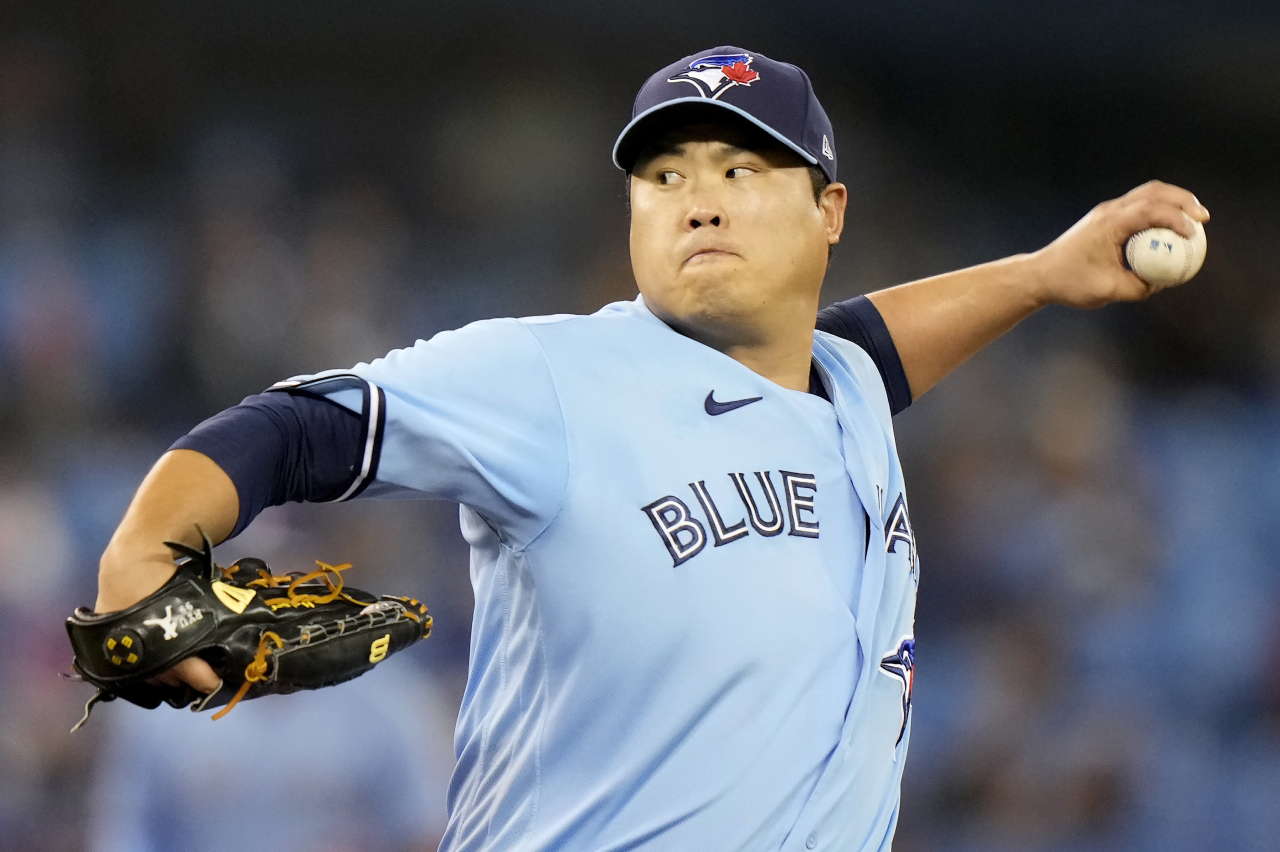 In this Canadian Press photo via Associated Press, Ryu Hyun-jin of the Toronto Blue Jays pitches against the Baltimore Orioles in the top of the first inning of a Major League Baseball regular season game at Rogers Centre in Toronto on Sunday. (AP-Yonhap)