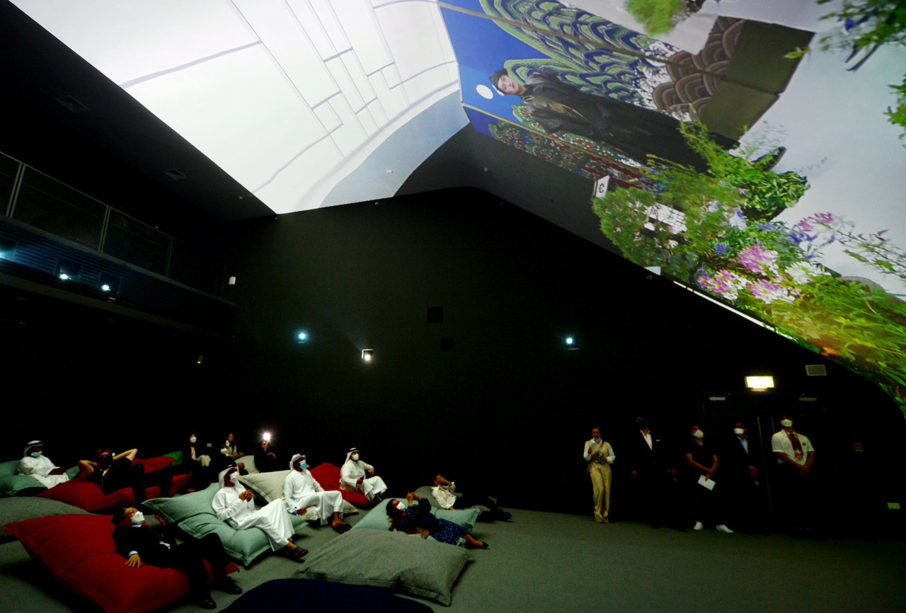 """Visitors watch """"the Journey of Wonder,"""" at the Vertical Cinema inside Korea Pavilion at the Expo 2020 Dubai. (Courtesy of Kotra)"""