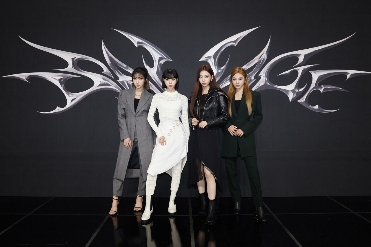 """Girl group aespa attends a press conference for the band's new album, """"Savage,"""" Tuesday. (S.M. Entertainment)"""