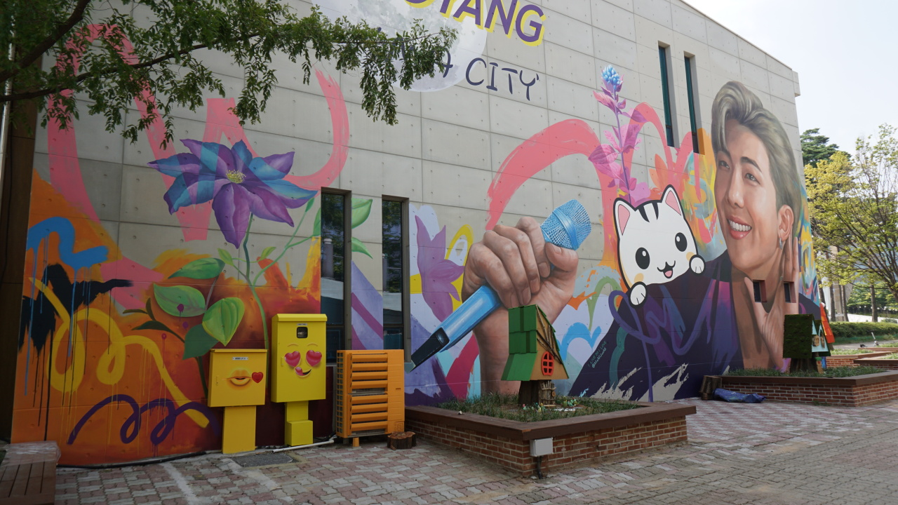 A mural of RM, a member of K-pop sensation BTS, is painted on the side of the Goyang Tourist Information Center. (Goyang City)