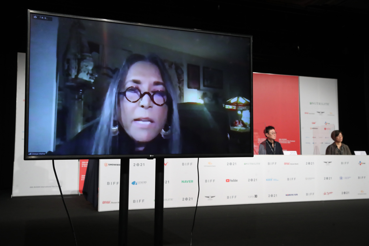 Deepa Mehta, president of the jury for the New Current Award, participates in a press conference held at the KNN theater in Busan via videoconference from Canada on Thursday. (Yonhap)